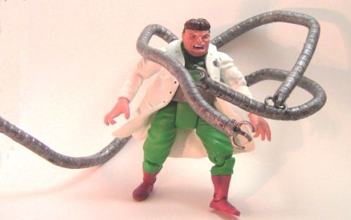 He is being braced by the tentacles against a wall. That's the only way this remotely works.